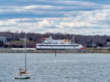 "The ""Woods Hole"" approaching the slip in Vineyard Haven as seen from the shore of The Lagoon."